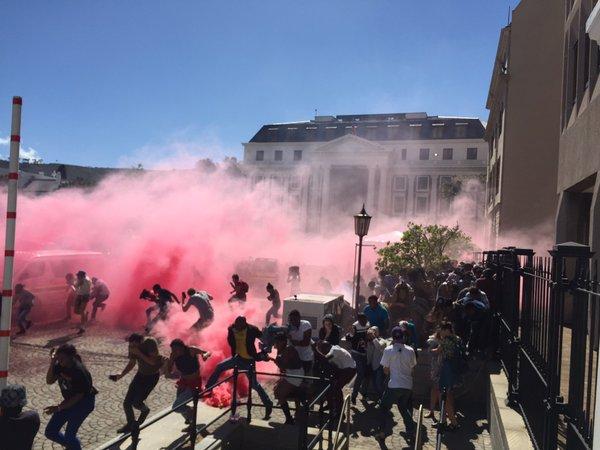 #NationalShutDown Police shooting teargas, stun grenades. #UCT #FeesMustFall via @LionelAdendorf https://t.co/MONCZp8Oz0
