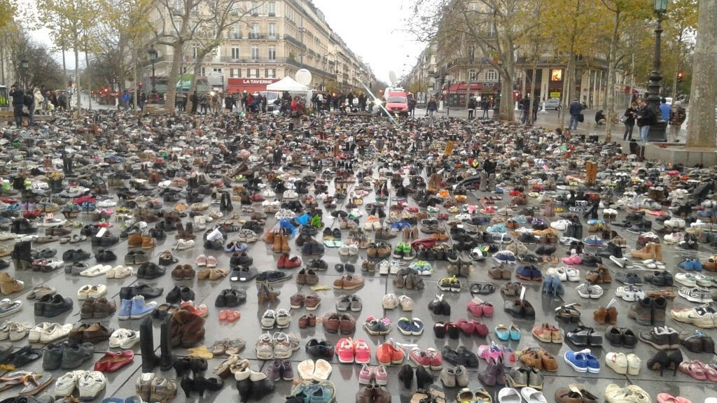 That's a lot of shoes!! Banned from marching Parisians sent in thousands of pairs to take part in the #ClimateMarch https://t.co/jSmTbMrejo