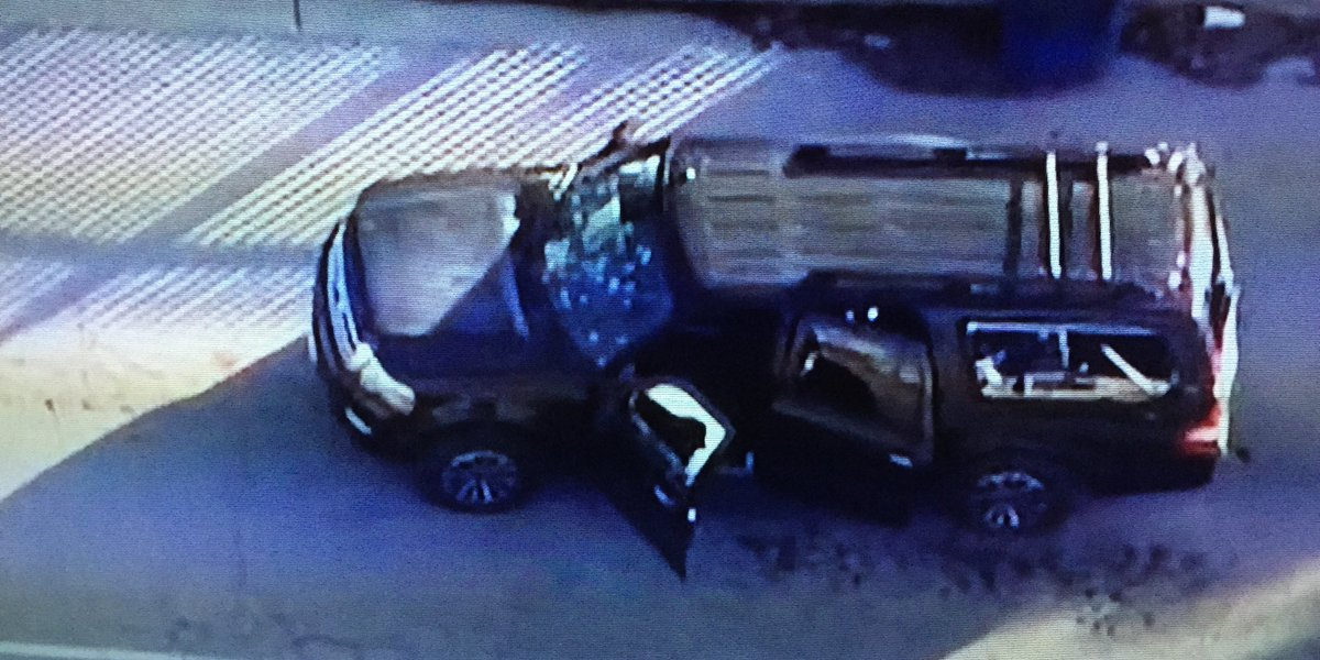 #SanBernadino suspect SUV is riddled with bullets. Cops slowly moving in. https://t.co/6voLlXMtig
