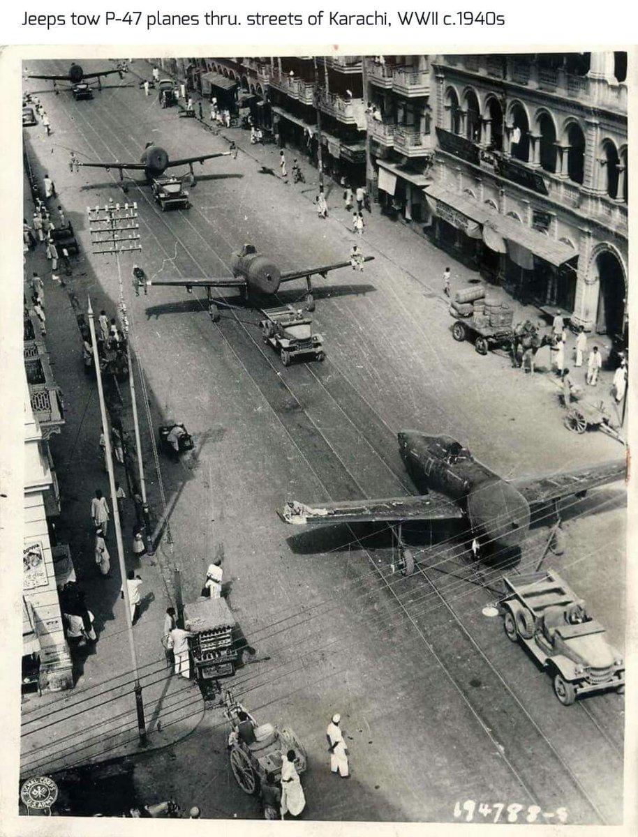 Jeeps tow P-47 planes thru. streets of Karachi, WW2 circa 1940s. https://t.co/0kGwcc5XdI