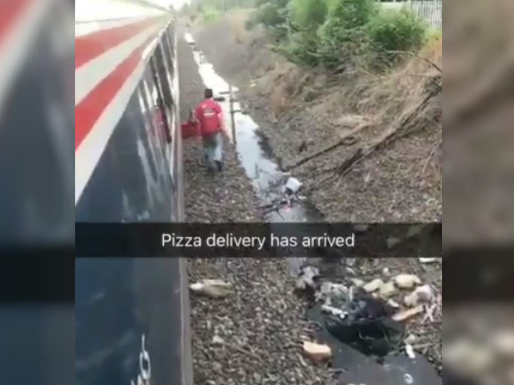 Man makes special pizza delivery for passenger of stuck train