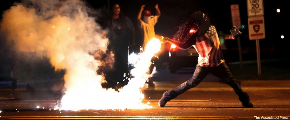Police say man in Ferguson photo is apparent suicide