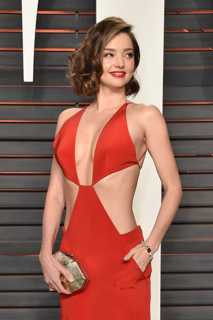 Miranda kerr wore a bright red #kaufmanfranco cutout gown with ...