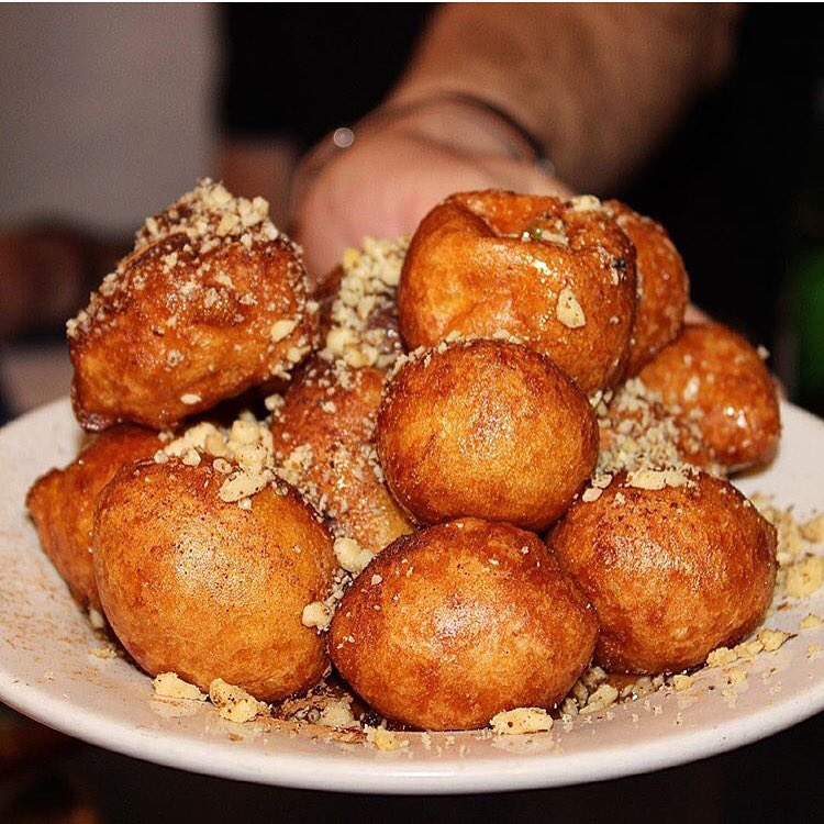 fried dough, drizzled with honey, walnuts, and cinnamon