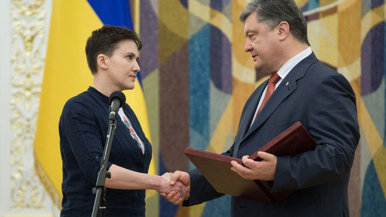 Poroshenko vows 'to bring back' E.Ukraine, Crimea after Putin pardons pilot