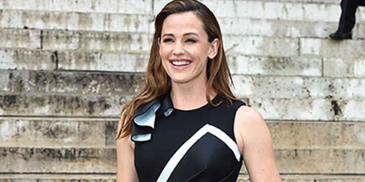 Jennifer Garner stuns in front row at Paris Fashion Week alongside Bradley Cooper