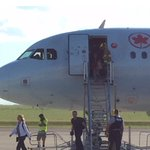 Passengers @ #Lethbridge #airport being escorted off after @AirCanada plane grounded (yyz-->yyc) due to #hailstorm https://t.co/Jp65lmbQaP