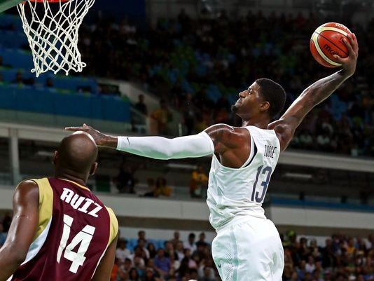 USA Basketball turns up defensive heat to steamroll Venezuela after slow start.