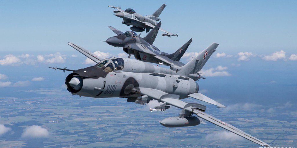 Stunning air-to-air photographs show the Polish Su-22, F-16, and Mig-29 flying together