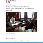 Photographer taking a photo of a photographer taking a photo of a narcissist signing a photo! Only @JustinTrudeau https://t.co/ZlpG76BixV