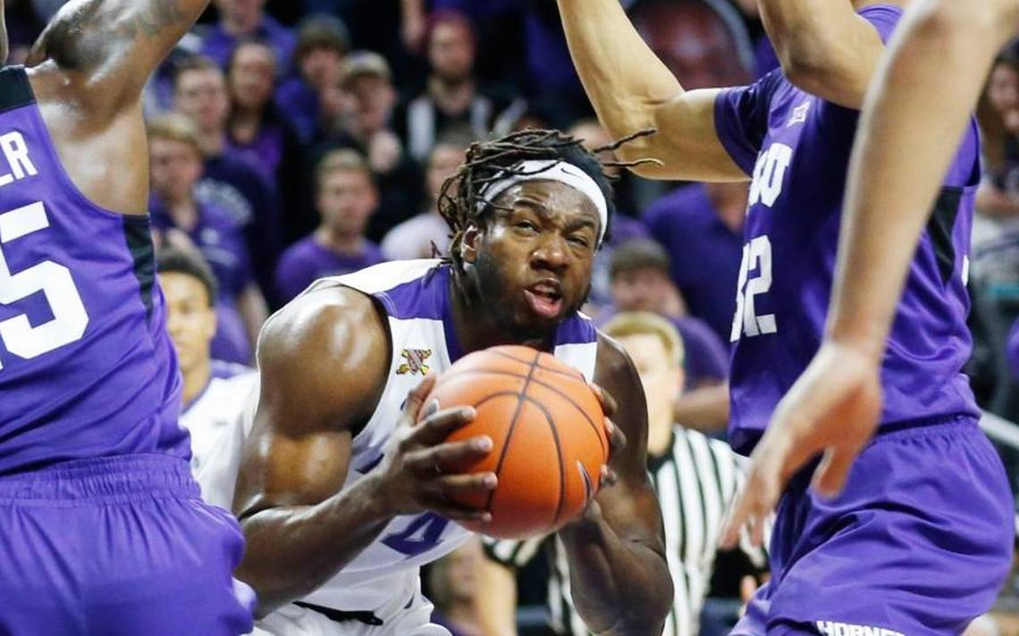 D.J. Johnson returns focus to basketball after NFL tryout