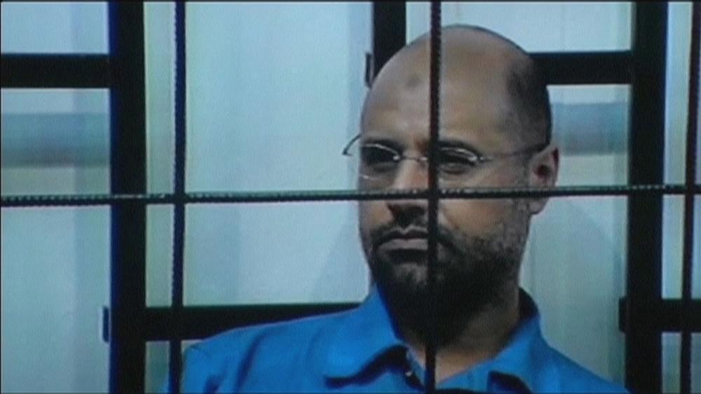 Wanted Gaddafi son freed by militia captors in Libya