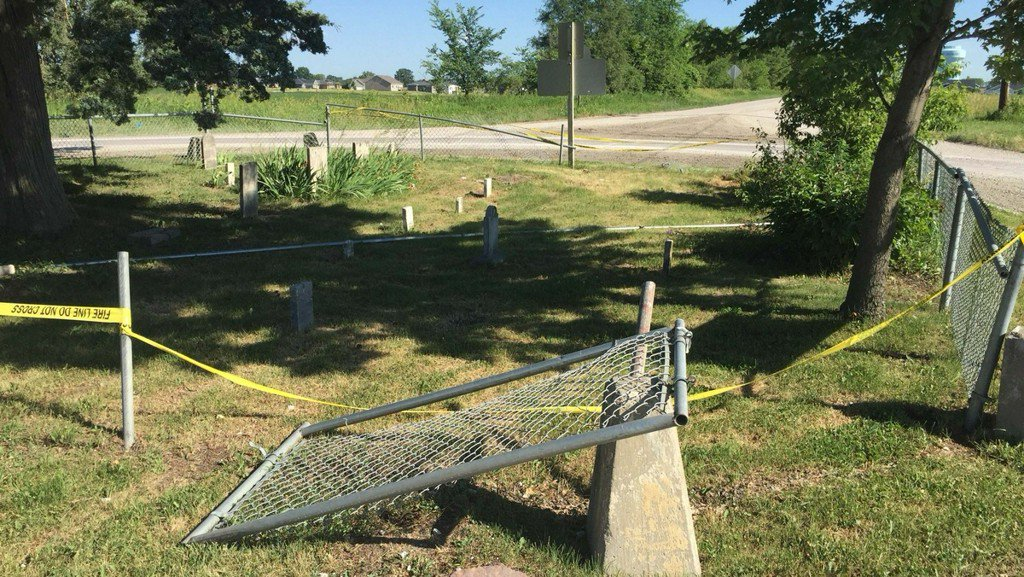Car crashes into historic cemetery that sits in city roundabout