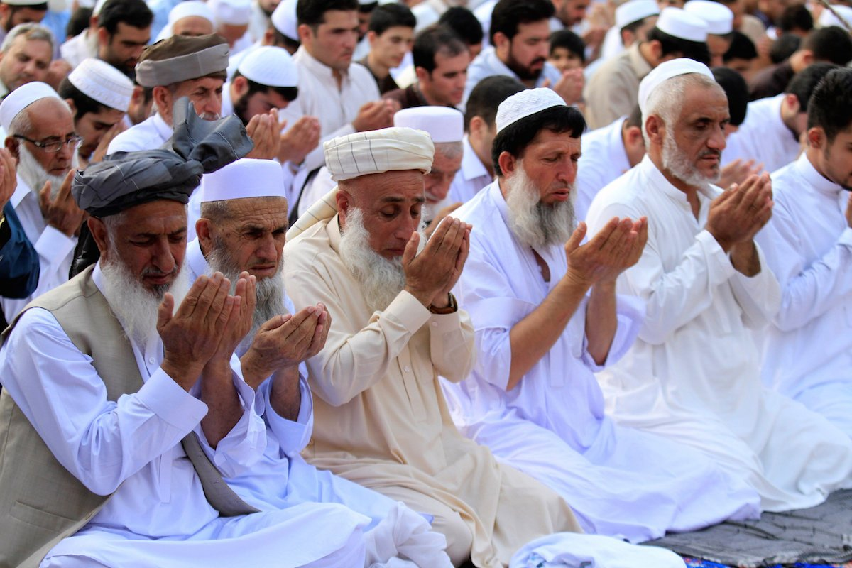 In Pictures: Muslims in Asia pray for peace as Ramadan holy month ends