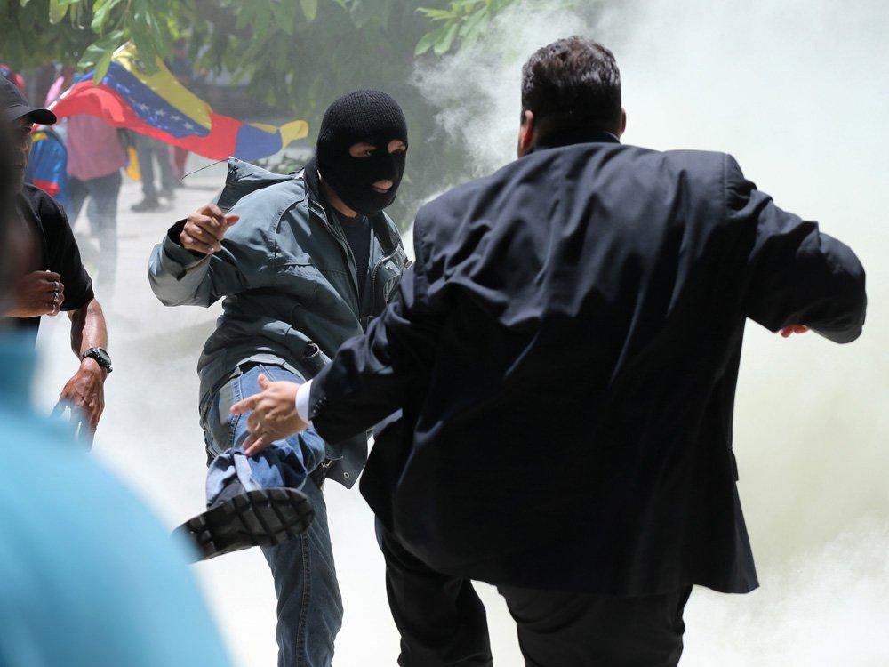 Pro-government militias storm Venezuela congress and attack opposition lawmakers