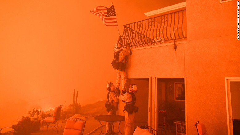 Surrounded by flames, California firefighters rescue American flag from wildfire