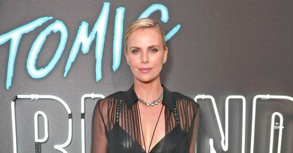 Charlize Theron as a female James Bond? She's into it.