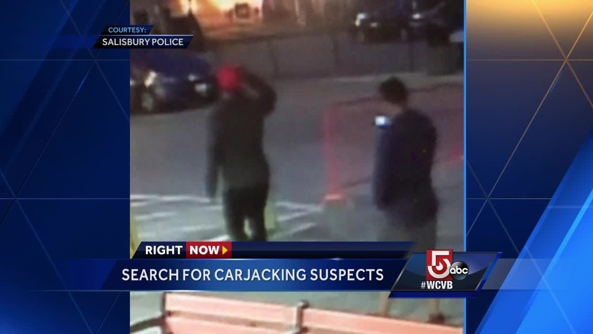 Police search for suspects in carjacking