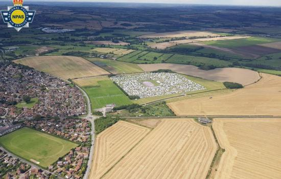 Amazing aerial pictures show how thousands of travellers have taken over an Oxfordshire field after it was booked out for Christian festival