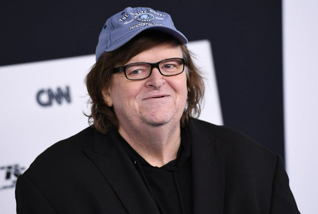 Michael Moore leads audience of Broadway play to Trump Tower