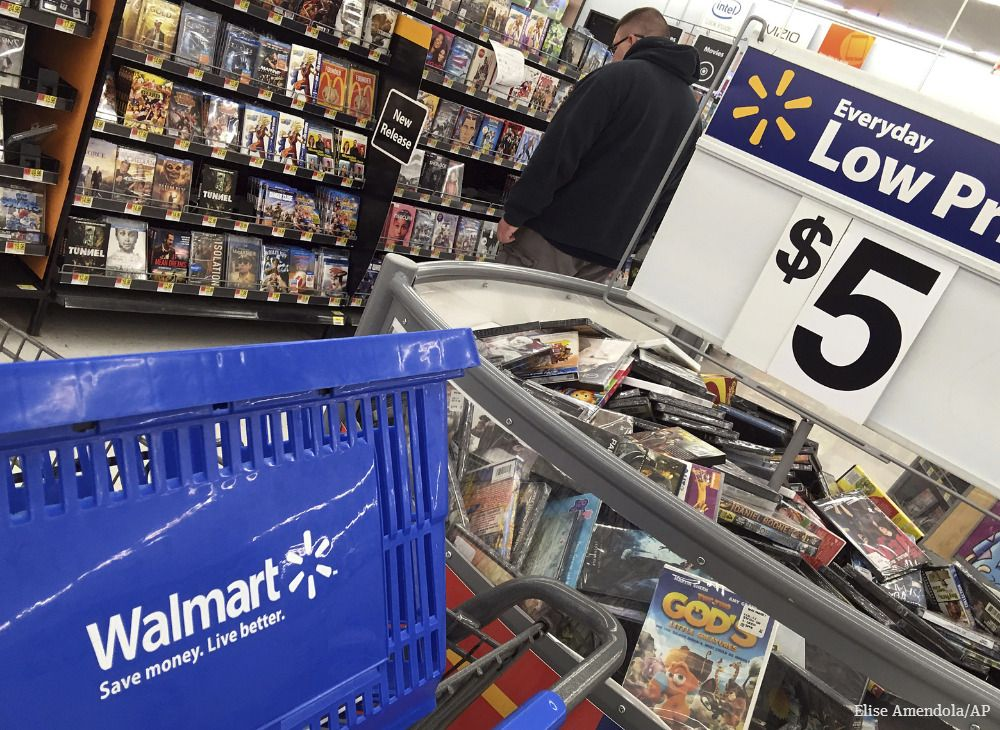 Wal-Mart gives tepid profit outlook as competition mounts with Amazon, grocery discounters