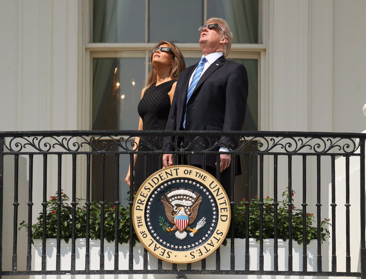 .@POTUS and @FLOTUS wear protective glasses as they view the #solareclipse at the @WhiteHouse. (AP Andrew Harnik)