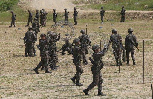 The Latest: Seoul says US, South's security advisers talk