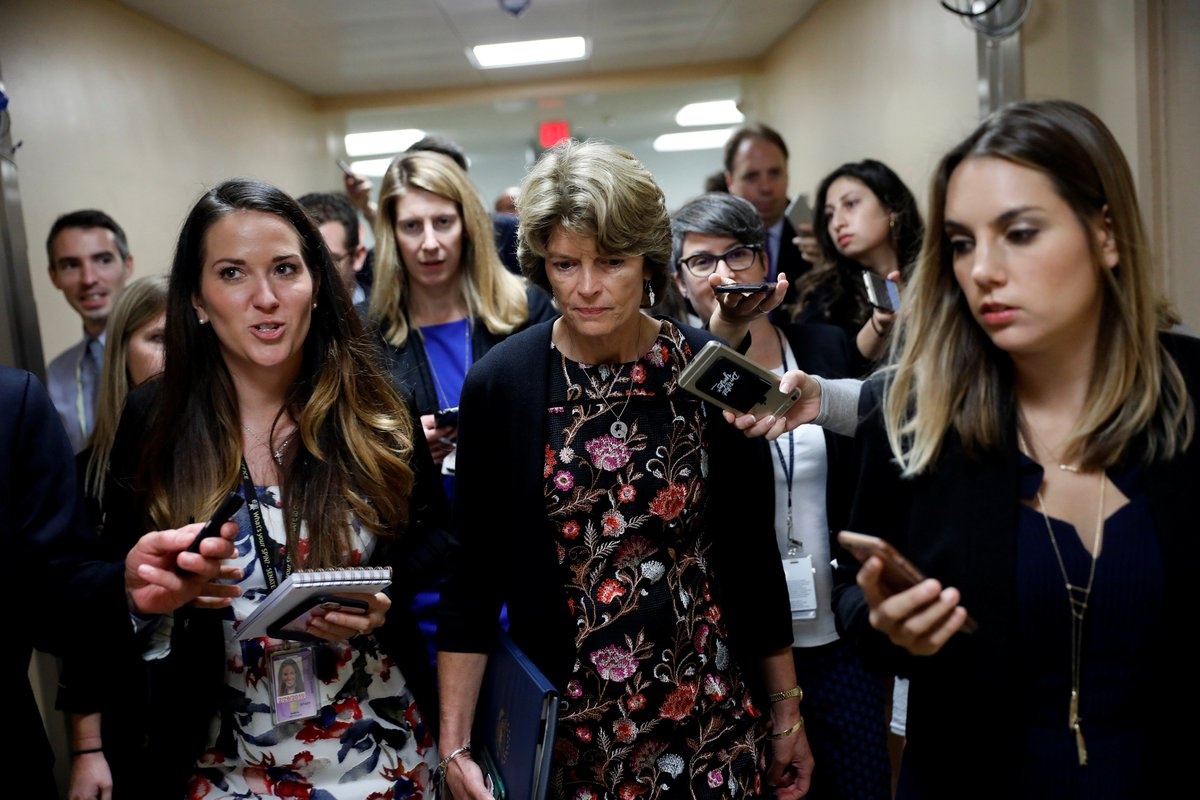 Murkowski again lands in the middle of the national health care debate