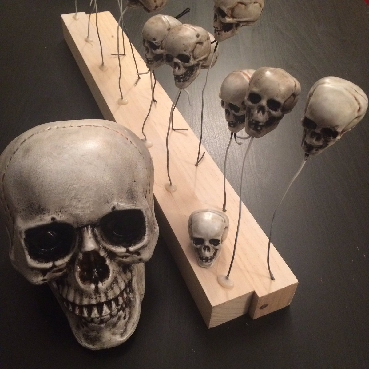 1 pic. Did a bit of art and craft today. Repainted bunch of skulls for gf Halloween costume. /