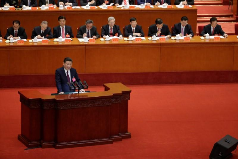 Xi says China will continue to open its economy, deepen financial reforms