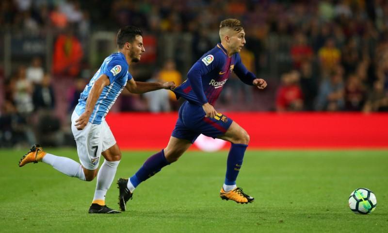 Controversial Deulofeu goal helps Barca ease past Malaga