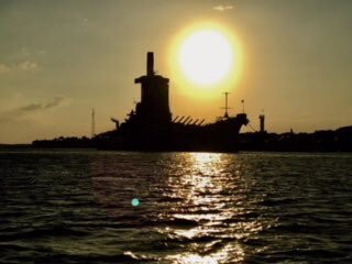 Sunset over USS Missouri, as she stands watch over the USS Arizona,  where America's bravest lay in rest. https://t.co/rRCEMWQpPi