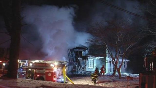 Crews battle house fire in Woodbridge