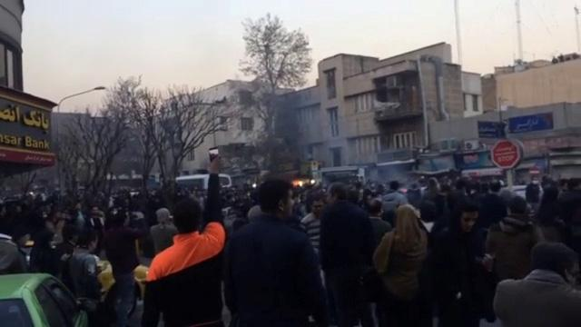 Iran treads cautiously as protests spread