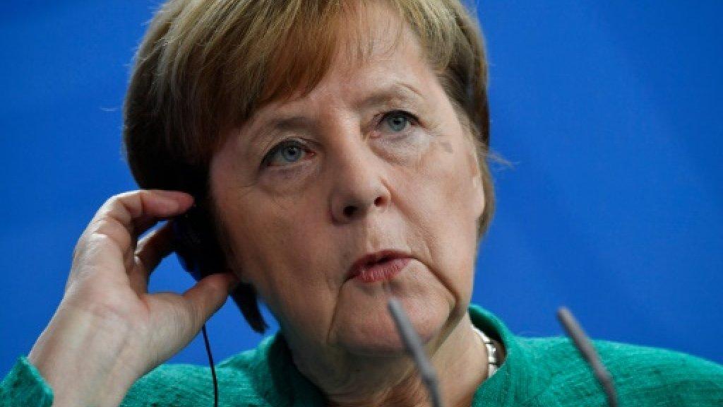 Merkel's fate in SPD hands as members vote on power pact