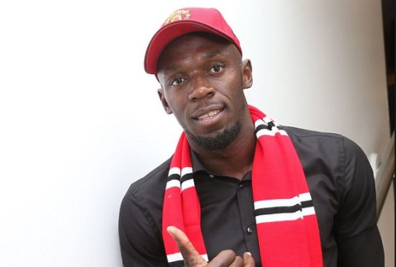Usain Bolt signs and is set to play at Old Trafford