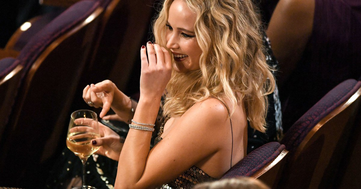 11 photos of Jennifer Lawrence drinking wine and living her best life at the Oscars: