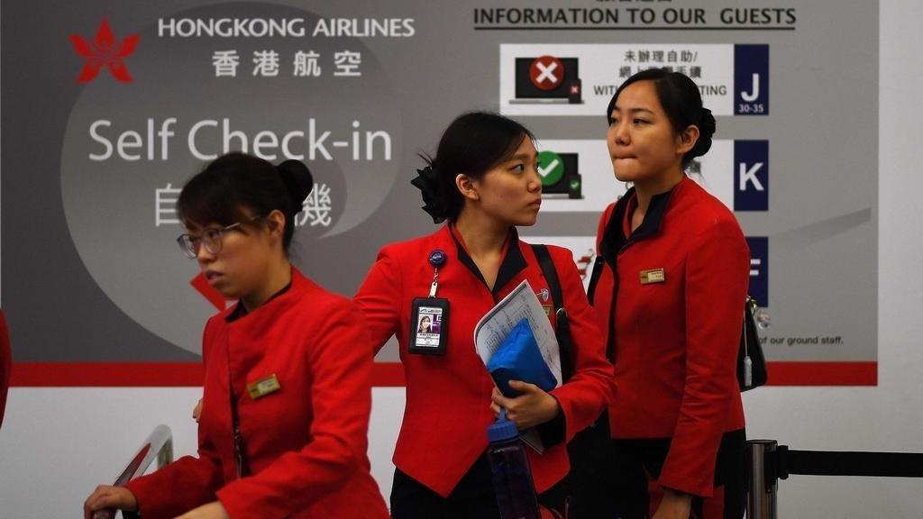 Hong Kong airport resumes flights as China accuses protesters of 'terrorism'
