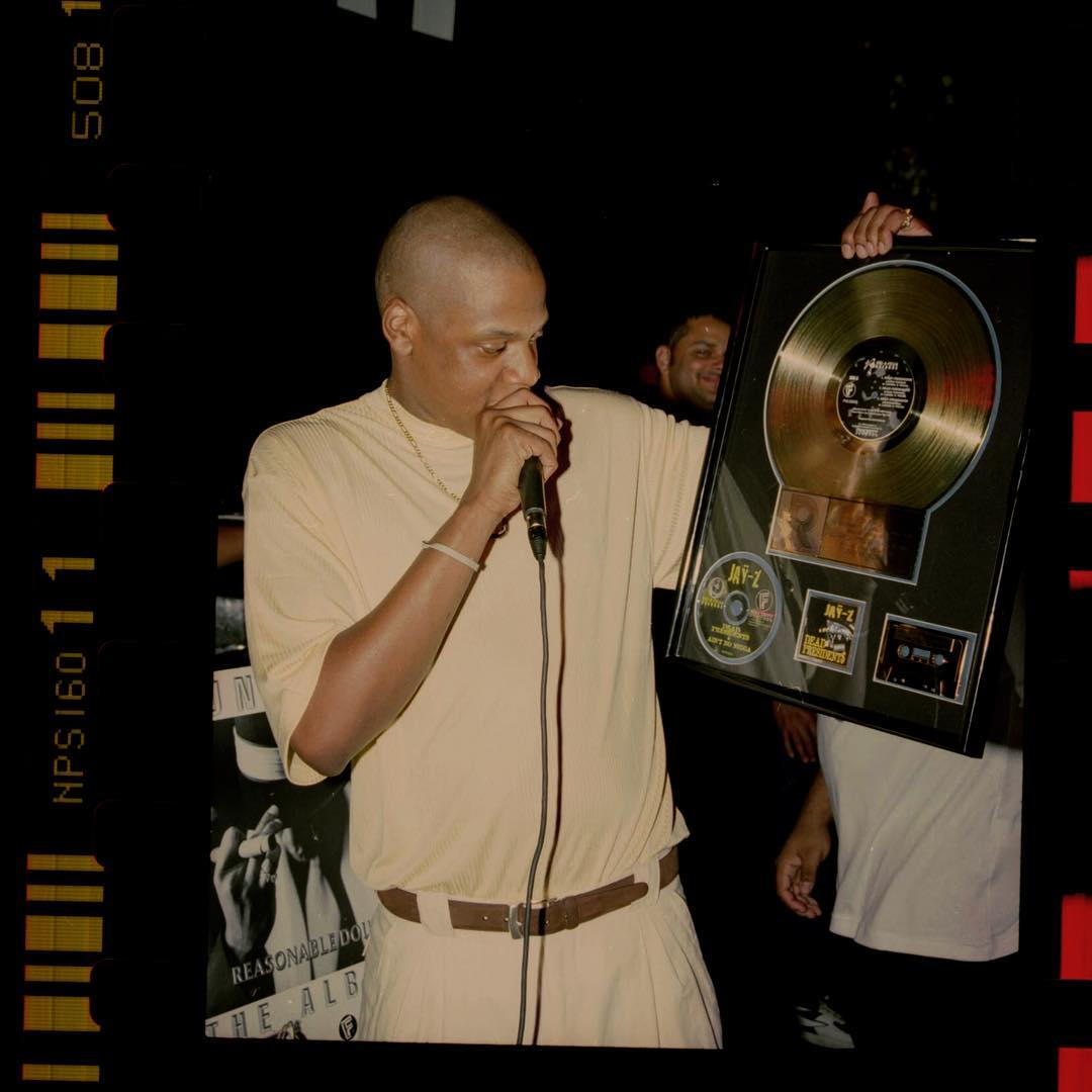 JAY-Z celebrating his first Gold Record ever - 1996  @LeleeLyons from SWV, Notorious BIG, @1996Biggs and Damon Dash  📸: Anderson Ballantyne
