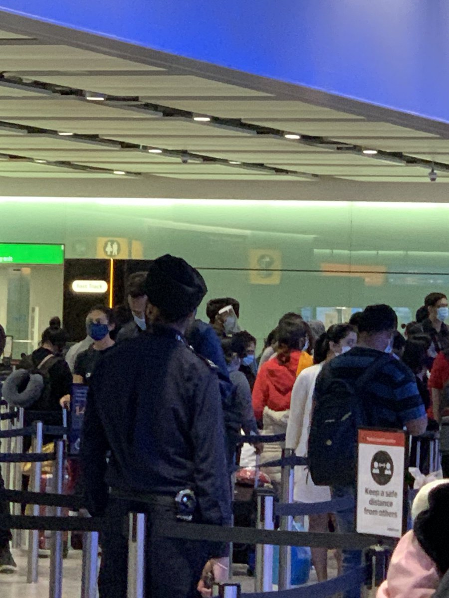 """Border control today at London's Heathrow Airport: No social distancing. Border control officers not wearing masks. Mine said she didn't have to (signs everywhere saying """"you must wear a face covering in the terminal""""). Hand sanitizer at her booth empty. Seriously??"""